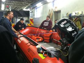 Lt. Bryan Rachko from the Lionville Fire Company briefs Berwyn crews on Boat 47-2. Fortunately the rain amounts we received were far less then what we saw during Hurricane Irene.