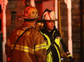 Berwyn Chief Matthew Norris and Radnor Chief Michael Maguire converse on the front lawn at the Maple Ave. house fire.