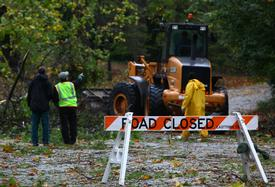 Easttown Twp. Public Works crews work to clear one of the manys road that became obstacle courses during the storm.