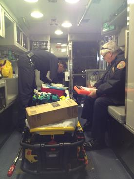Steve Webb, Chester County Deputy Director of Emergency Services, inspects our new ambulance.  Berwyn Paramedic Tom Spurlock assists with the inspection.