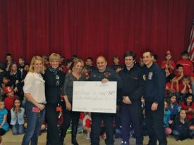 Beaumont Home and School Association parents Jean Allen, Colleen Lynum and Kerri Martin present a check for $750 to Berwyn Fire Company first responders Fred Nudy, Josh Lichman and Evan Brazunas.