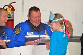 Easttown Police Officer Tony Howe accepts a thank you card from a Beaumont student.
