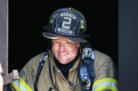 FF Harry Burke helps clean up after an evolution.  FF Burke is a great example of how important experience and training are to a successful fire company as demonstrated on numerous fires in the Berwyn area.