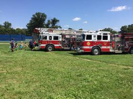 Firefighters from Newtown Square Fire Company (Ladder 41) and Radnor Fire Company (Squad 15) showed the campers their trucks and how to use a fire extinguisher.