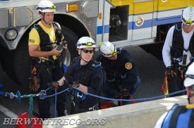 Firefighter/EMT William 'Bill' King in the yellow, freshly back from his deployment with Team Rubicon in the Texas area impacted by Hurricane Harvey, is functioning as the Incident Commander for this complex confined space scenario.