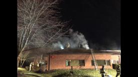Firefighters worked in tandem to contain the fire to one section of the building before it could spread into an adjoining building.