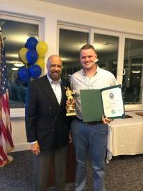 Chester County Commissioner Terence Farrell presented Eric Javie with a special citation for achieving the Firefighter of the Year honors.