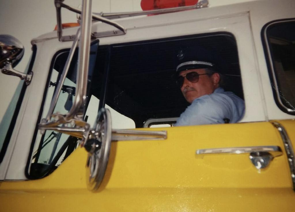 Bill driving a Berwyn fire truck in the 100th Anniversary Parade in 1994.