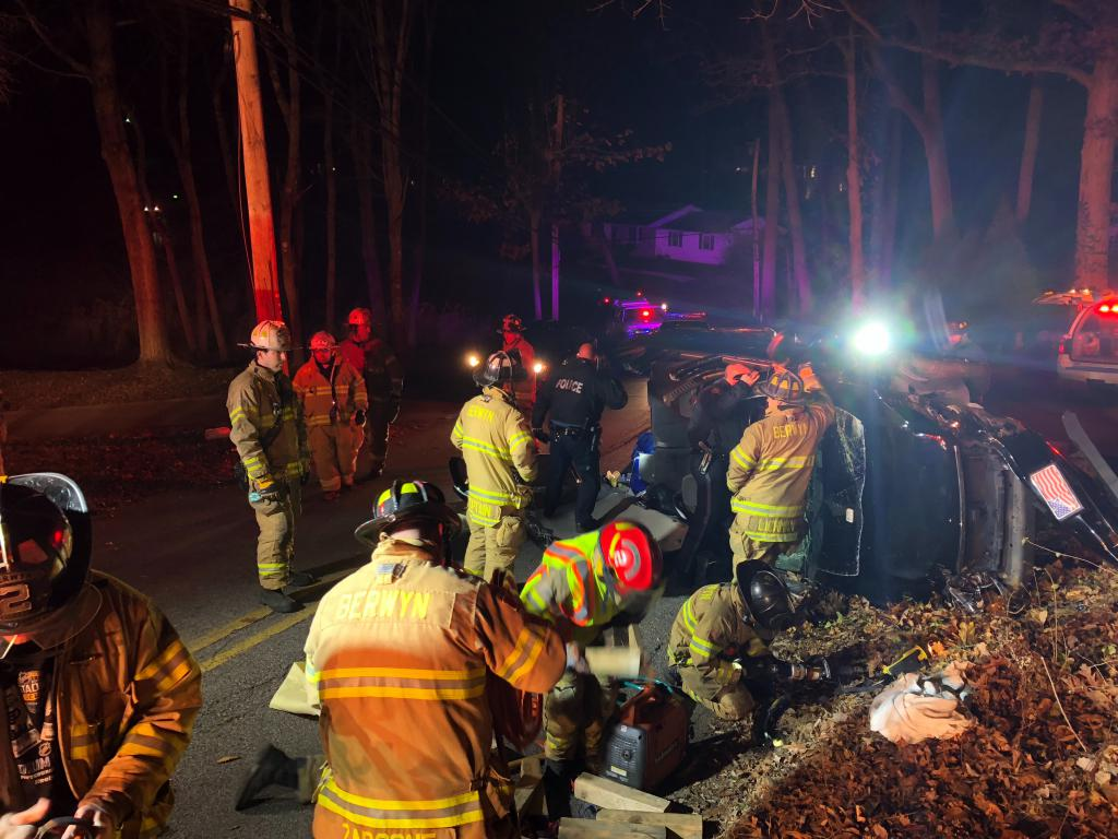 Firefighters begin to clean-up the scene after the driver was extricated from this crash.