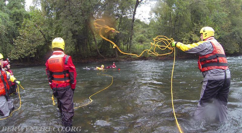 Battalion Chief Ted Brawn performs a rope bag throw during a training session. This technique is used so a victim can grab onto the rope and be pulled to shore.