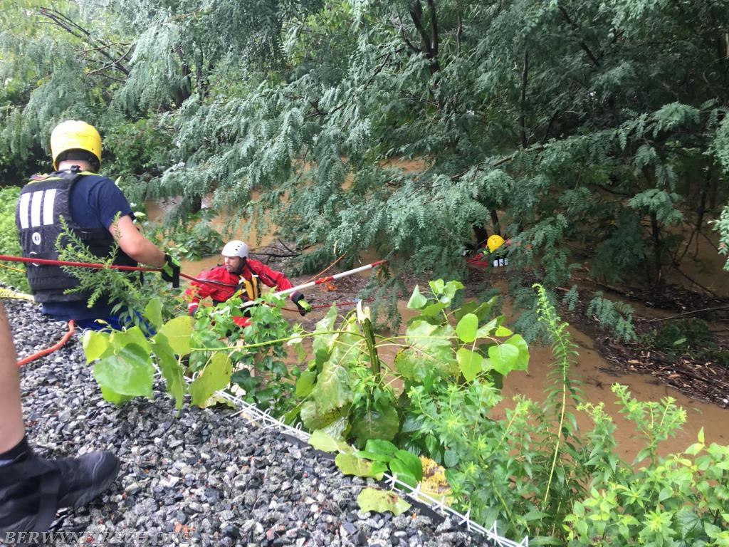 Rescuers successfully reaching a victim swept away into a storm water culvert on August 13, 2018.