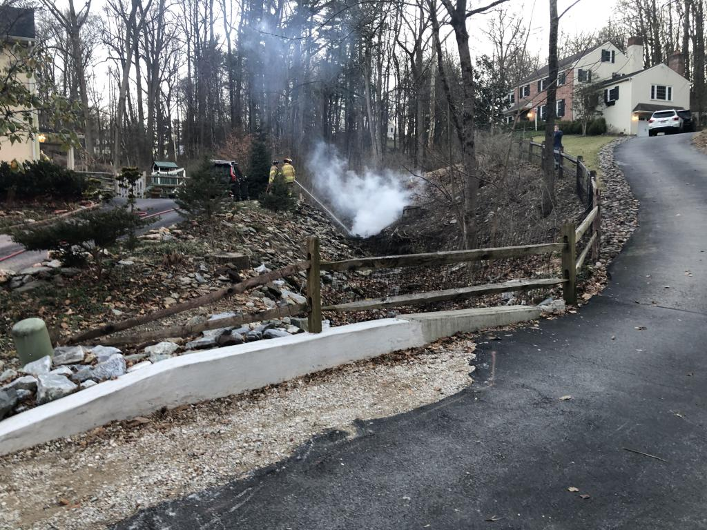 Firefighters extinguishing a brush fire on Spoonwood Circle in Tredyffrin Township.