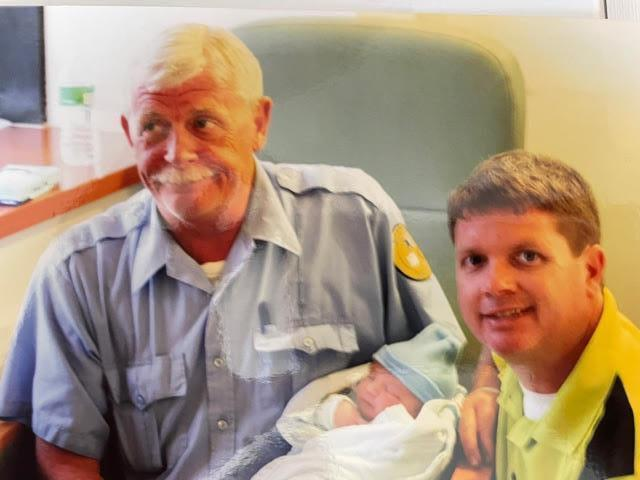 Charlie meeting one of his 5 beautiful grandchildren for the first time with son Chucko by his side.