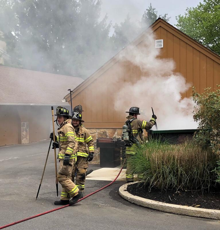 Firefighters operating at the dumpster fire in the Valley Stream Village of Chesterbrook on Sunday.