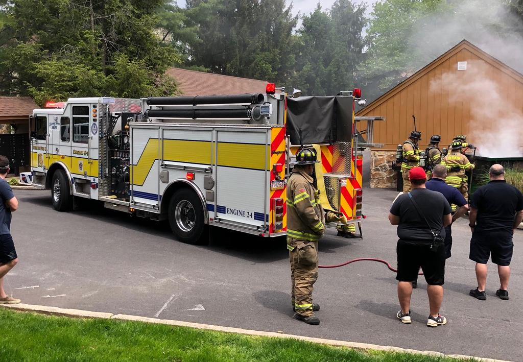 The crew of Berwyn Engine 2-1 extinguishing a dumpster fire in Valley Stream Village of Chesterbrook on Sunday.